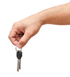 Male hand holding keys isolated Royalty Free Stock Photos