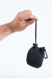 A male hand holding a lens pouch Royalty Free Stock Image