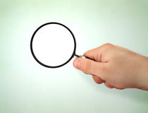 Male hand holding magnifying glass Royalty Free Stock Photos