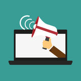 Male hand holding megaphone coming out from laptop. Concept for digital marketing, promotion and advertising. Flat design  i Royalty Free Stock Photo