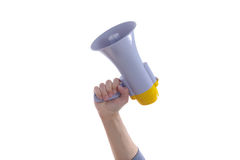 Male hand holding a megaphone or loud haler. Male hand holding up a megaphone or loud haler, side view isolated on white Stock Photos