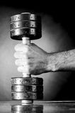 Male hand is holding metal barbell Royalty Free Stock Images