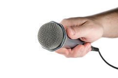 Male hand holding microphone. Male hand holding microphone on white background Stock Photos