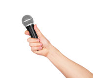 Male hand holding microphone Stock Photos