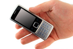 Male hand holding mobile phone. The screen is cut with clipping path Royalty Free Stock Photo
