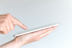 Male hand holding modern tablet or large smart phone. Stock Photography