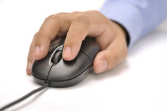 Hand Holding A Mouse. Male hand holding a mouse. This is working concept photo Royalty Free Stock Image