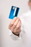 Male hand holding a new cash card Stock Images