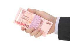 Male hand holding pack of Thai baht notes Royalty Free Stock Photos
