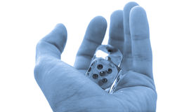 Male hand holding a pair of dice Stock Photo