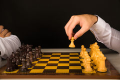 Male hand holding pawn Royalty Free Stock Image