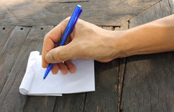 Male hand holding pen. Asian male hand holding pen on an empty paper Royalty Free Stock Photos