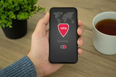 Male hand holding phone with app vpn private network stock image