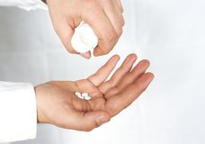 Male hand holding pills Stock Photo