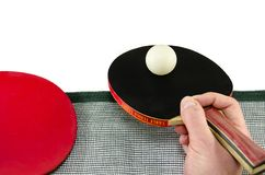 Male hand holding a ping pong racket, isolated Royalty Free Stock Image