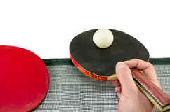 Male hand holding a ping pong racket, isolated Royalty Free Stock Photography