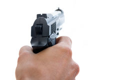 Male hand holding a pistol. On a white background Stock Photography