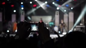 Male Hand Holding Record Video Camera Zoom Smartphone Live Concert Performance Taking Photo Music Band Silhouettes stock footage