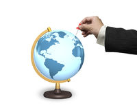 Male hand holding red pushpin with terrestrial globe Stock Photo