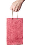 Male hand holding red shopping bag isolated on white Stock Photography