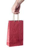 Male hand holding red shopping bag isolated on white Royalty Free Stock Photos