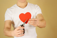 Male hand holding red Valentines card with heart on  bac Royalty Free Stock Images