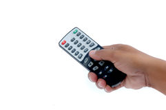 Male hand holding a remote controller. Isolated on white background Royalty Free Stock Image