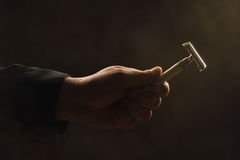 Male hand holding safety razor Royalty Free Stock Photography