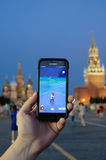 Male hand holding a Samsung Galaxy smartphone with a running Pok. JUL 31, 2016 MOSCOW: Male hand holding a Samsung Galaxy smartphone with a running Pokemon Go Stock Image