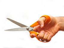 Male hand holding scissors. Man hand holding a pair of sharp scissors. Isolated on a white background Royalty Free Stock Image