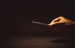 Male Hand Holding a Screwdriver. Conceptual composition, man's hand holding a screwdriver Stock Photo