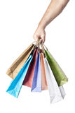 Male hand holding shopping bags isolated on white Stock Images