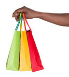 Male hand holding shopping bags. Isolated on white background Stock Photo