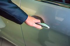 Business man hand holding car doorhandle Stock Images