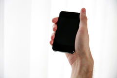 Male hand holding smartphone Stock Photos