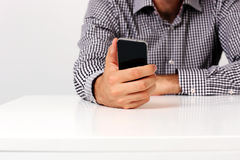 Male hand holding smartphone Royalty Free Stock Image