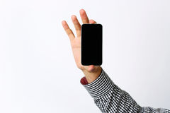 Male hand holding smartphone Stock Images