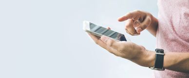 Male hand holding smartphone,mobile with copy space Royalty Free Stock Image