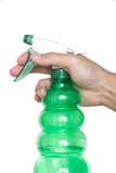 Male hand holding spray bottle Royalty Free Stock Photo