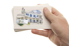 Male Hand Holding Stack of Flash Cards with House Drawing Stock Image