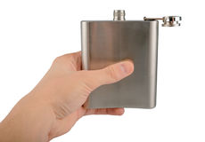 Male hand holding stainless hip flask isolated on white background stock photos