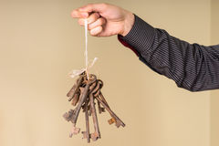 Male Hand Holding String of Antique Rusty Keys Royalty Free Stock Image