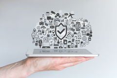 Male hand holding tablet. Concept of cloud computing security and mobile computing. Royalty Free Stock Photo