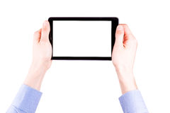 Male hand holding a tablet PC with space for you text Royalty Free Stock Photo