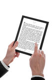 Male hand holding a touchpad pc showing an E-Book. A male hand holding a touchpad pc showing an E-Book, isolated on white stock photography