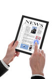 Male hand holding a touchpad pc showing newspaper Stock Images