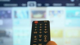 Smart TV. Male hand holding TV remote control. Smart TV stock video footage