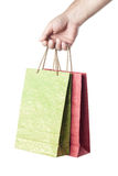 Male hand holding two shopping bags isolated on white. Background Stock Images