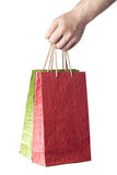 Male hand holding two shopping bags isolated on white. Background Royalty Free Stock Photo