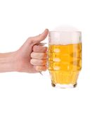 Male hand holding up a glass of beer. Stock Photo
